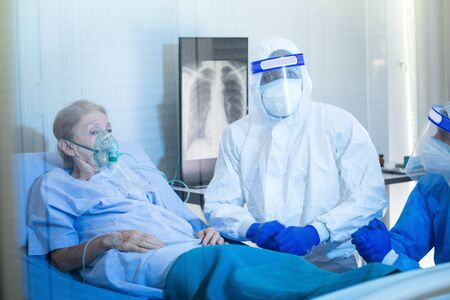 Old Female patients despaired in hospital beds After being infected with coronavirus - covid19. The medical team is providing full treatment. Stock Photo
