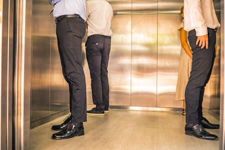 Social Distancing on Elevator with passenger stand in the corner from outbreak of coronavirus covid19 situation. Concept of aware safe and low risk.