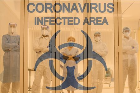 Medical team with background of coronavirus sign in the quarantine room