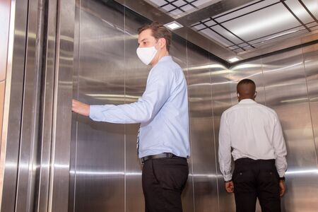 Social distancing concept on the elevator. Stockfoto
