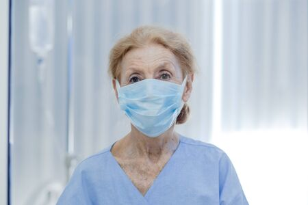 Old woman patient is in state quarantine from coronavirus covid19 outbreak and stay in the quarantine room.