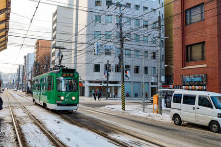 Sapporo, Hokkaido, Japan - December 2019 : Tram city line service brings tourists to take the cable car (Ropeway) up to the Mount Moiwa to go to the Scenery spot, Hokkaido