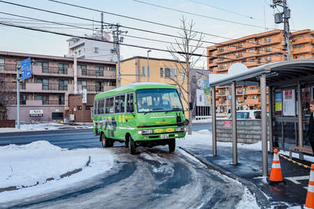Sapporo, Hokkaido, Japan - December 2019 : Bus service brings tourists to take the cable car (Ropeway) up to the Mount Moiwa to go to the Scenery spot, Hokkaido