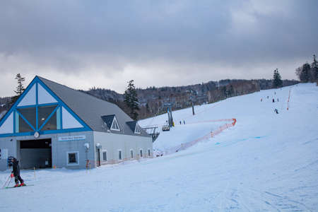 Area of Kiroro ski resort. Skiers and Snowboarders Ride the Gondola at Kiroro Ski Resort during winter with fully of snow ground in Hokkaido, Japan.