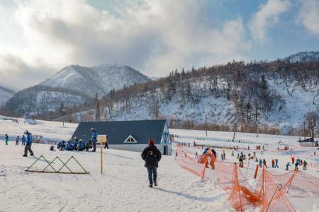 Area of Kiroro ski resort. Skiers and Snowboarders Ride the Gondola at Kiroro Ski Resort during winter with fully of snow ground in Hokkaido, Japan.