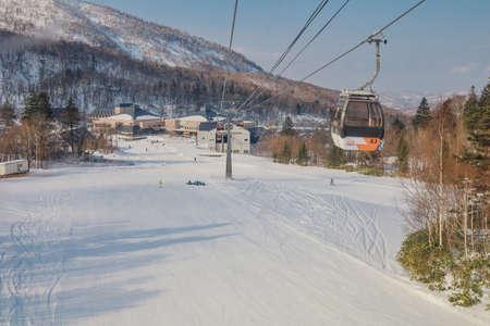 Hokkaido, Japan - December 2019 : Area of Kiroro ski resort. Skiers and Snowboarders Ride the Gondola at Kiroro Ski Resort during winter with fully of snow ground in Hokkaido, Japan.