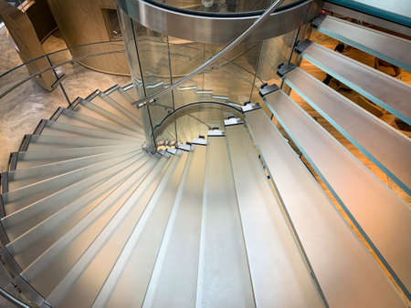 Glass stairs at Co-Working Space on social distancing with luxury comfortable design for work as free and relax. Concept of creative cooperate work space for startup mobile office. 免版税图像