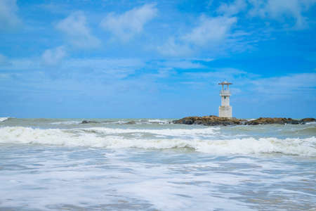 Khao lak lighthouse at Phang Nga Province. Lighthouse located in the middle of the sea, Hightlight of Nang Thong Beach. There are beautiful rocks sparsely, soft white sand.