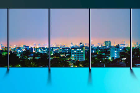 Panoramic skyline and buildings from glass window - Cityscape during twilight time Foto de archivo