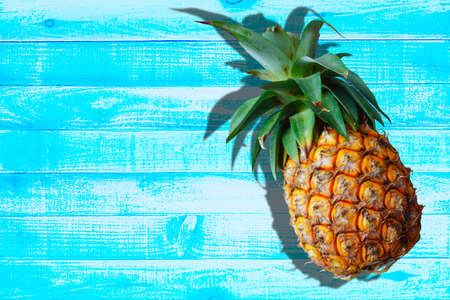 Pineapple summer female on wooden blue Backgrounds flat-lay - Top view, wide composition Stockfoto