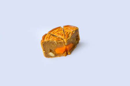 """Moon cakes doing half on a white background - Chinese mid autumn festival background. The Chinese character """" Zhong qiu """""""