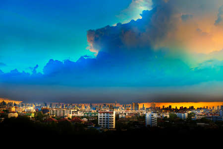 Cityscape under clouds and blue sky