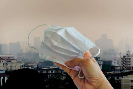 Dust mask for people live in pollution - Backgrounds building Banco de Imagens