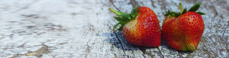 Design of standard horizontal web banners with space for text - Top view strawberry on wooden table background