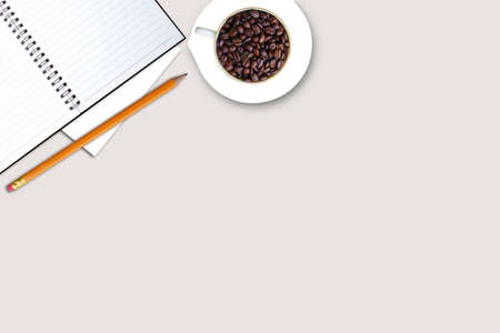 Office desk top view with coffee bean and Blank note Banco de Imagens