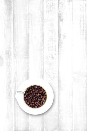 Top view of roast Coffee Beans in a cup on wooden table background with copy space - Cup full of coffee beans Banco de Imagens