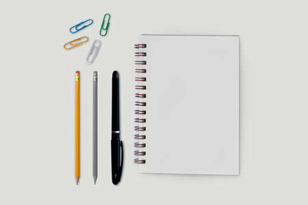 Flay lay, Top view notebook and pencil isolated on white background Banco de Imagens