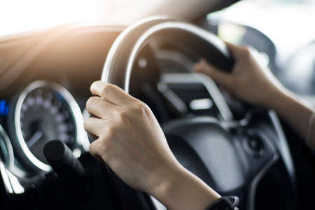 woman driving car hand on steering