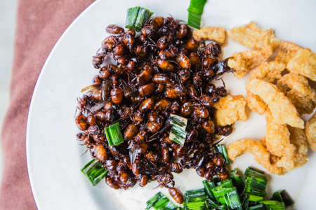 chicharon: Fried subterranean ants with pork crackling and pandanus leafs.