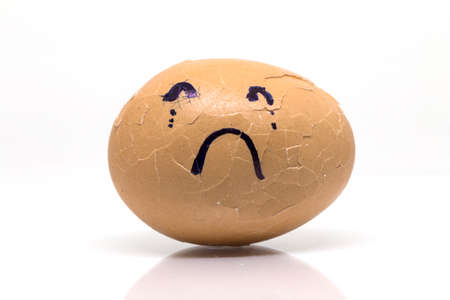 broken eggs: Eggs broken in sad emotion on isolate white background. Stock Photo