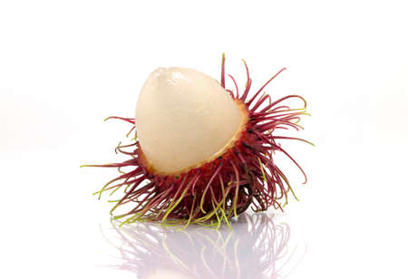 derived: rambutan sweet delicious fruit isolated on white background. The name rambutan is derived from the Malay-Indonesian languages word for rambut or hair