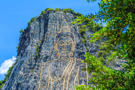 chan: Khao chee chan the largest buddha carved in the world with trees , Pattaya, Thailand