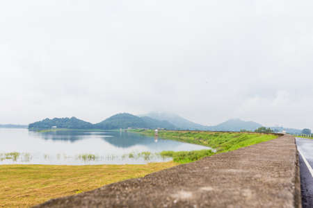 reservoirs: The streets of large reservoirs with the mountain early in the morning at Thailand Stock Photo