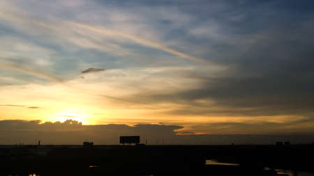 hometown: Silhouette of sunset from Hometown in thailand. Downtown landscape.