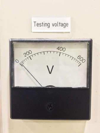 volts: Old style voltmeter gauge. Voltage meter of test room for measurement voltage on controller panel. Testing voltage scale 0-600 Volts.
