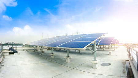 Soft focus of Solar panels or Solar cells on factory rooftop or terrace with sun light, Industry in Thailand, Asia. Can saving energy. Sun energy. renewable energy. Clean energy. 스톡 콘텐츠