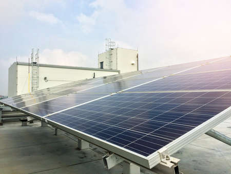 Soft focus of Solar panels or Solar cells on factory rooftop or terrace with sun light, Industry in Thailand, Asia. Can saving energy. Sun energy. renewable energy. Clean energy. Stock Photo