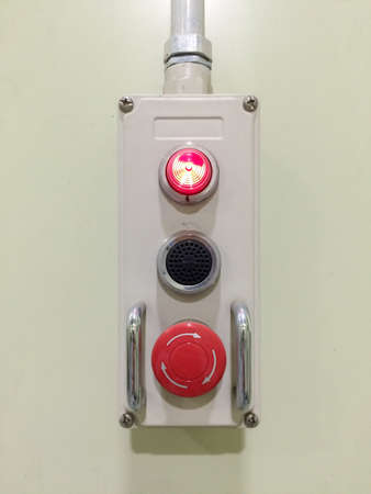 The Pneumatic switch, Emergency button, Emergency switch. Emergency button on machine in factory, for protect accident and stop(off) machine stop immediately. Stock Photo