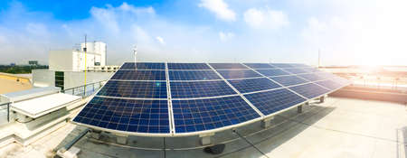 Soft focus of Solar panels or Solar cells on factory rooftop or terrace with sun light, Industry in Thailand, Asia. Can saving energy. Sun energy. renewable energy. Clean energy. Stockfoto