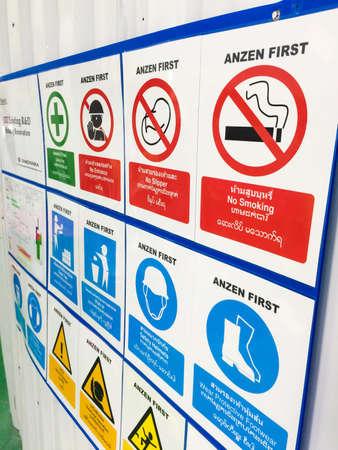 no entrance: Warning Sign, No entrance, No Slipper, No Smoking, Safety first, Safety helmets, General danger. Include English language,Thai Language, Burmese Language, Lao language. white background. Construction area.