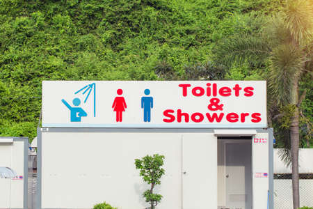 knockdown: sign of public toilets and shower for women and men. Public toilets and shower knockdown room. Stock Photo