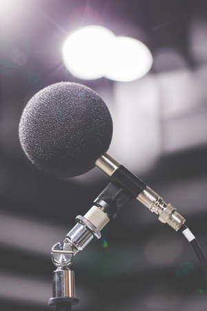 amplification: High accuracy microphone in noise (sound) testing room with LED light bokeh. High technology. Microphone for nosie recorder. Selective focus. Stock Photo