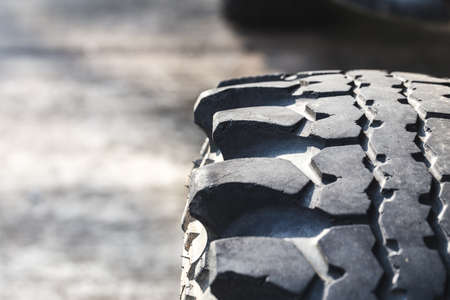 fourwheeldrive: Detail of old off-road vehicle tire with beautiful sunlight.