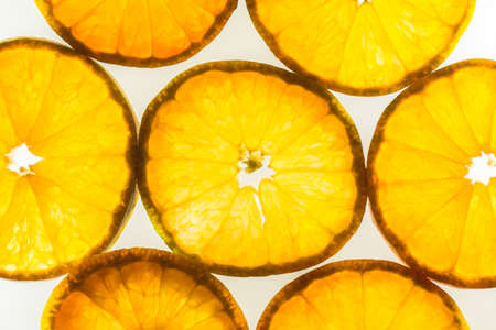 Soft focus,Abstract background with silhouette citrus-fruit of orange slices. Close-up. Studio photography.