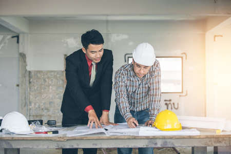 Management consulting or engineer and labor woman working with management consulting with engineers working with blueprint and drawing on work table in for management business malvernweather Choice Image