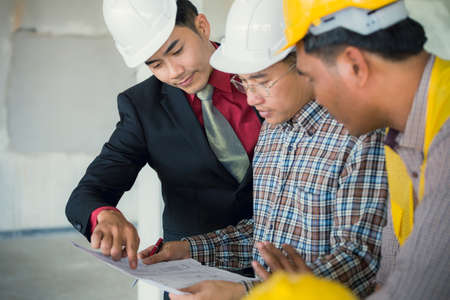 Management consulting or engineer and labor woman working with management consulting and engineers and foreman working with blueprint and drawing on work table for management malvernweather Choice Image