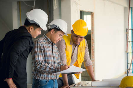 Management consulting and engineers and foreman working with management consulting and engineers and foreman working with blueprint and drawing on work table for management malvernweather Choice Image