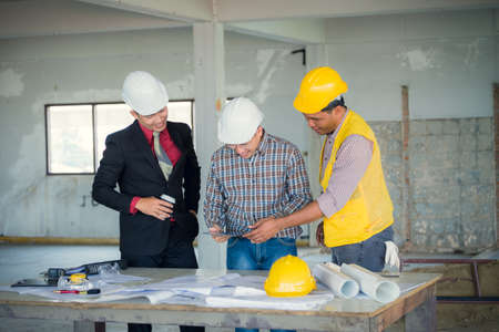 Management consulting with engineers working with blueprint and management consulting and engineers and foreman working with blueprint and drawing on work table for management malvernweather Choice Image