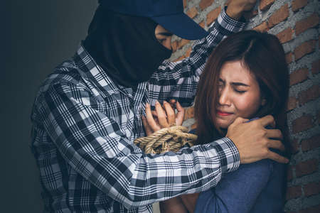 maltreatment: Sexual abuse with a terrorist attacking a scared woman in a dark place. Rape and Sexual abuse concept.