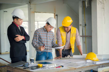 Management consulting and engineers and foreman working with stock management consulting and engineers and foreman working with blueprint and drawing on work table for management malvernweather Images
