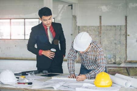 Management consulting and engineers and foreman working with stock management consulting with engineers working with blueprint and drawing on work table in for management business malvernweather Choice Image