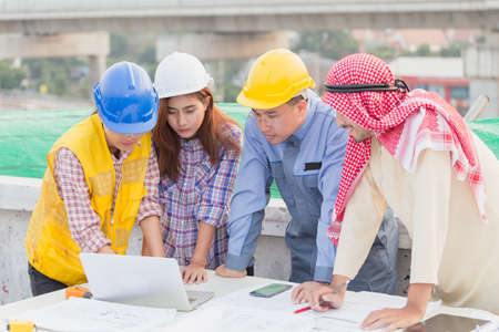 Harmonious Muslim engineer and technician team meeting in building construction site. Stacking hands. Teamwork collaboration relation concept Stock Photo