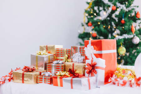 christmas gift box and christmas decoration with christmas tree at back side copy space for