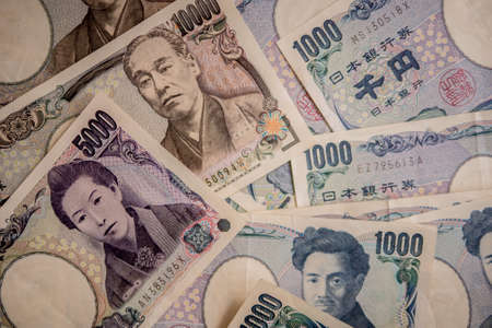 Japanese Yen Banknotes close up shot and stack layers. japanese currency. financial and economy money concept.