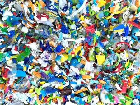 Bottle flake,PET bottle flake,Plastic bottle crushed,Small pieces of cut colorful plastic bottles Editorial