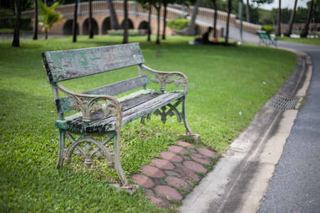 Old vintage bench in the park photo